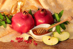 Rosh hashanah symbols - honey, apples and pomegranate Royalty Free Stock Image