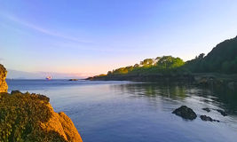 Roshin Port, Killybegs, on a Summer's Evening. The view from the shoreline at a small beach at Roshin Port, Killybegs, Donegal, West Ireland on a beautiful stock photo
