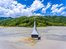 Rosia Montana Geamana lake and flooded Church. Environmental dis Royalty Free Stock Images