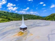 Rosia Montana Geamana lake and flooded Church. Environmental dis Stock Images