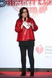 Rosie O'Donnell fala na fase na pista de decolagem no vermelho ir para a coleção vermelha 2015 do vestido das mulheres Imagem de Stock Royalty Free