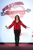 Rosie O'Donnell fala na fase na pista de decolagem no vermelho ir para a coleção vermelha 2015 do vestido das mulheres Foto de Stock Royalty Free
