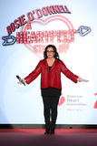 Rosie O'Donnell speaks on stage on the runway at the Go Red For Women Red Dress Collection 2015 Royalty Free Stock Photo