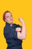 Rosie the riveter. Photo re make of Rosie the riveter fron world war 2, with clipping path Stock Images