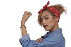 Rosie the Riveter. Beautiful woman dressed as the iconic Rosie the Riveter Stock Photo