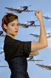 Rosie the Riveter. Beautiful woman dressed as the iconic Rosie the Riveter Royalty Free Stock Images