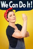 Rosie riveter dungarees we can do it. Self-confident middle aged woman with dungarees flexing her muscles, speech bubble with text WE CAN DO IT, tribute to Stock Images