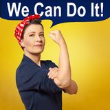 Rosie riveter woman copy space. Tough and self-confident woman with a clenched fist, speech bubble with text WE CAN DO IT, tribute to american icon Rosie Riveter Stock Photography