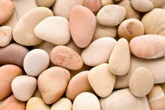 rosiga pebbles arkivbilder
