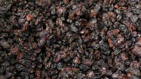 Rosinen als Hintergrundtrauben-Rosinenbeschaffenheit Rosinen im Supermarkt lizenzfreie stockfotos