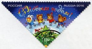 ROSJA - 2016: przedstawienie nowego roku okręgu taniec w łyżwiarskim lodowisku, oddany nowy rok 2017 obraz royalty free