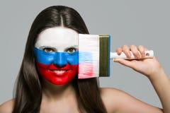 Rosja ` s flaga malował na twarzy fotografia royalty free