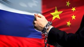 Rosja sankcjonuje Chiny, konflikt, przykuwającego ręk, politycznego lub ekonomicznego, handlu zakaz zdjęcie royalty free