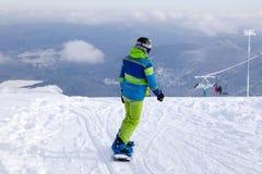 Rosja, Sheregesh 2018 11 17 profesjonalistów snowboarder w brązie s zdjęcie royalty free