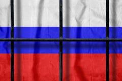 Rosjanin flaga za czarnymi metalu więzienia barami z cieniami zdjęcie royalty free