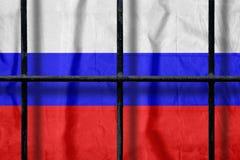 Rosjanin flaga za czarnymi metalu wi?zienia barami z cieniami zdjęcie stock