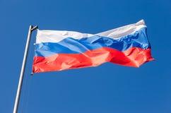 Rosjanina chorągwiany falowanie w wiatrze Obraz Royalty Free
