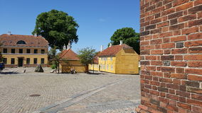 Roskilde central square. The central square of Roskilde is a national treasure of Denmark with its historic cathedral and yellow plaster houses royalty free stock images