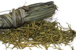 Rosmarini ed erbe asciutte su un fondo fotografia stock
