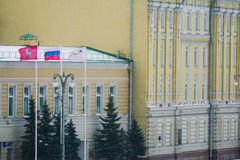 Rosneft - office at the Sofia Embankment in Moscow. Flags, old mansion, winter, snow royalty free stock photo