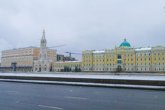 Rosneft - office at the Sofia Embankment in Moscow. Flags, old mansion, winter, snow stock photo