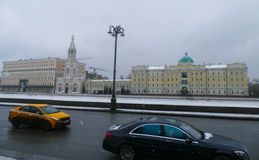 Rosneft - office at the Sofia Embankment in Moscow. Flags, old mansion, winter, snow ,cars royalty free stock photo