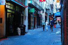 Ross Alley, Chinatown. Tourists stroll through Ross Alley in San Francisco`s Chinatown Royalty Free Stock Image