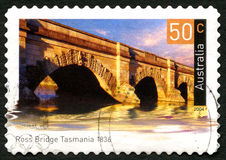 Ross Bridge in Tasmania Australian Postage Stamp. AUSTRALIA - CIRCA 2004: A used postage stamp from Australia, depicting an image of Ross Bridge in Tasmania royalty free stock image