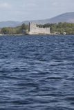 Ross Castle across the water at Lough Leane, Killarney Stock Images