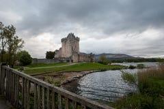 Ross castle in Killarney. Stormy skies over Ross castle in Killarney Royalty Free Stock Images