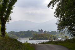Ross castle lake at the end of a killarney forest path Stock Photography