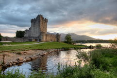 Ross castle. View of Ross castle in Killarney (co Kerry, Ireland) with dramatic clouds in the evening light athmosphere royalty free stock image