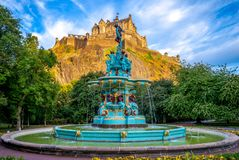 Edinburgh Castle and Ross Fountain. The Ross Fountain is a cast-iron structure located in West Princes Street Gardens, Edinburgh royalty free stock photos