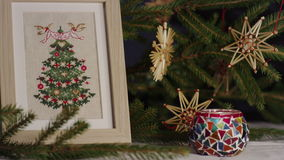 Сross stitch and wooden ornaments for Christmas trees stock video