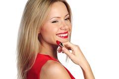 Rossetto di colore rosso della donna Immagini Stock