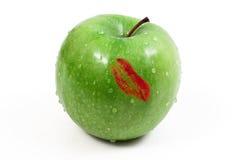 Rossetto su una mela Fotografia Stock