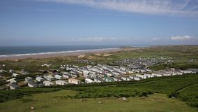 Rossili beach with caravans towards Hillend on The Gower peninsula South Wales UK PAN stock video
