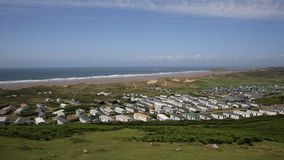 Rossili beach with caravans towards Hillend on The Gower peninsula South Wales UK PAN stock video footage