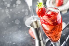 Rossini alcoholic cocktail with Italian sparkling wine, strawberry puree and ice in champagne glasses, place for text, selective. Focus royalty free stock photo