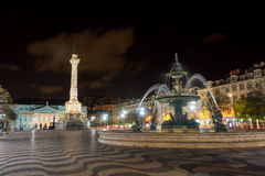 Rossio or Pedro IV Square at night in Lisbon Stock Photos