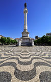 Rossio square in the central Lisbon with a monument of the king Pedro IV. Royalty Free Stock Images