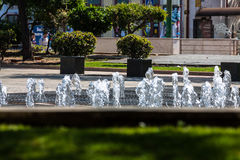 Rossio square with fountain located at Baixa district in Lisbon, Royalty Free Stock Photos
