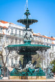 Rossio square with fountain located at Baixa district in Lisbon,. Portugal Stock Photography