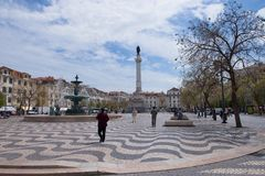 Rossio Square, Lisbon, Portugal. Baroque fountain and Dona Maria II National Theater on Rossio Square in Lisbon, Portugal Royalty Free Stock Photos