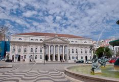 Rossio Square, Lisbon, Portugal. Baroque fountain and Dona Maria II National Theater on Rossio Square in Lisbon, Portugal Royalty Free Stock Photo