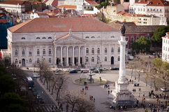 Rossio Square or Praça de Dom Pedro IV. This square has always been a popular meeting place, no matter the purpose – both feasts and executions used to take Stock Photos