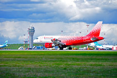 Rossiya Airlines Airbus A319 airplane in new livery is landing in Pulkovo International airport, Saint Petersburg, Russia Royalty Free Stock Photo