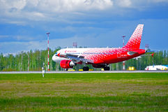 Rossiya Airlines Airbus A319 airplane in new livery is landing in Pulkovo International airport Stock Photo