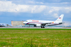 Rossiya Airlines Airbus A319 airplane is riding on the runway after arrival from Pulkovo International airport in Saint-Petersburg Royalty Free Stock Photo