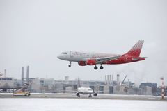 Rossiya - Russian Airlines Airbus A319-100 VP-BIS landing on snowy airport Stock Photos